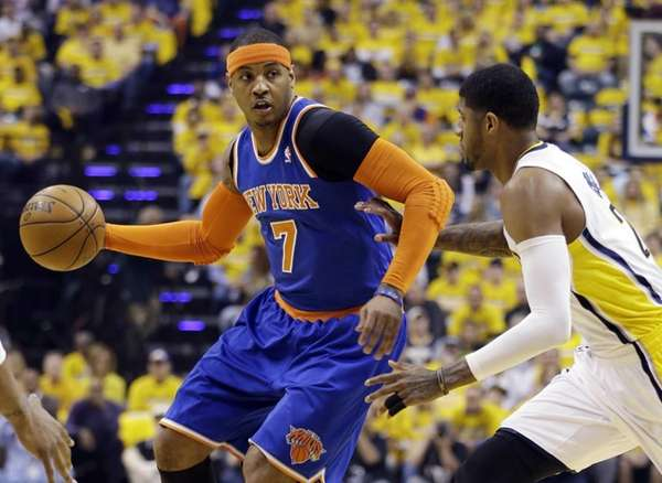 Knicks' Carmelo Anthony tries to drive past Indiana