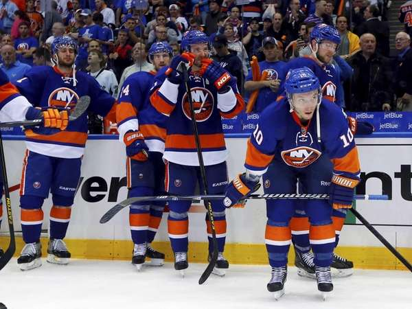 The Islanders look on after losing in OT