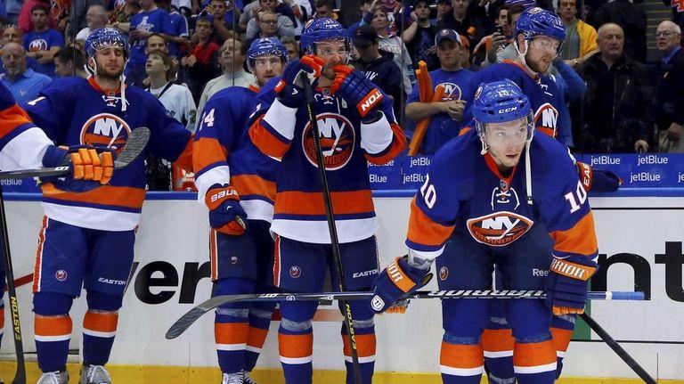 The Islanders look on after losing in OT