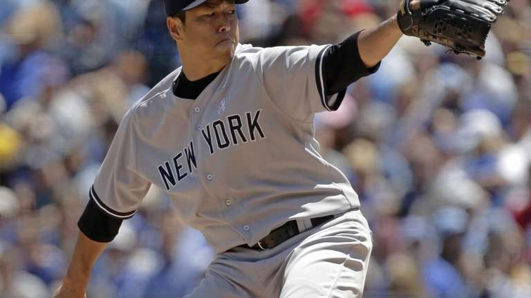 Hiroki Kuroda delivers a pitch during the first
