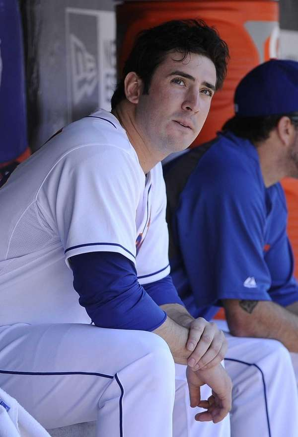 Matt Harvey looks on from the dugout in