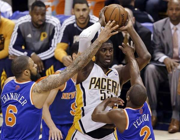 Indiana Pacers center Roy Hibbert is defended by