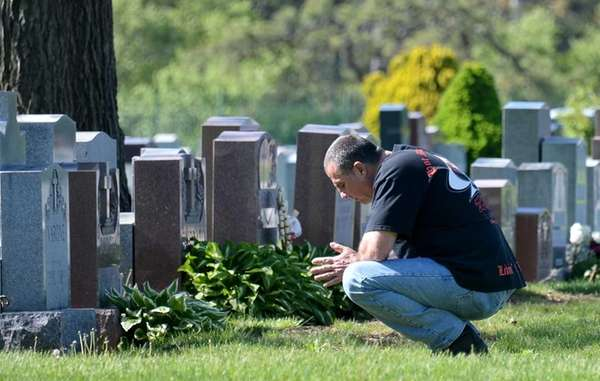 Ken Karabec, of Lindenhurst visits the grave of