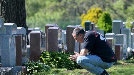 Ken Karabec, of Lindenhurst visits the grave of