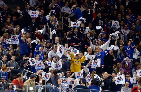 Rangers fans wave their towels during the first