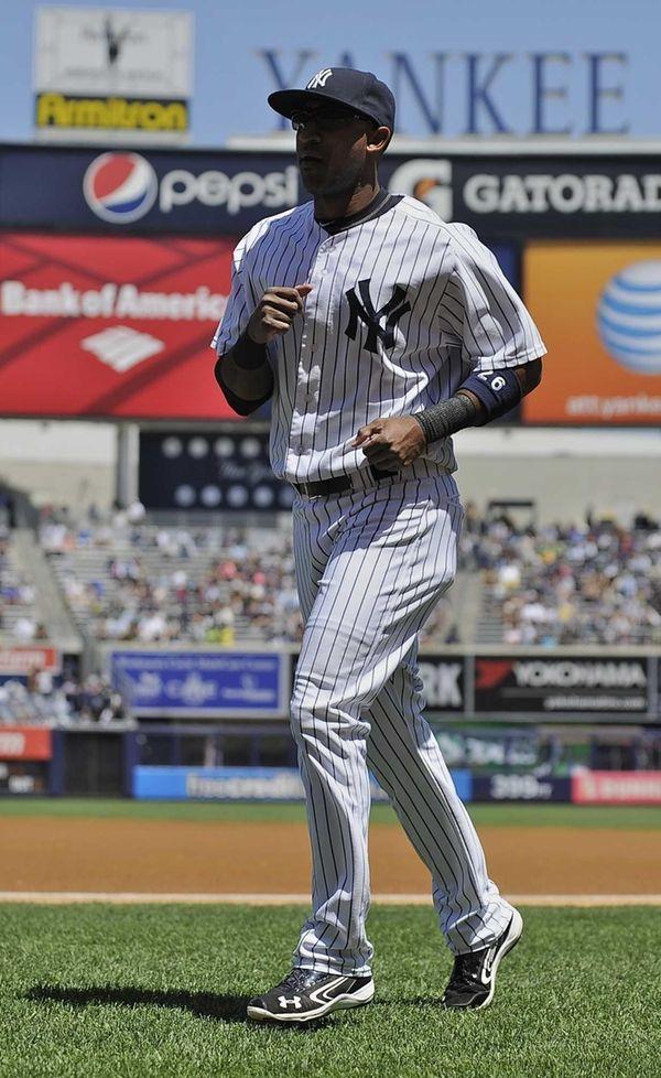 Eduardo Nunez runs onto the field before the