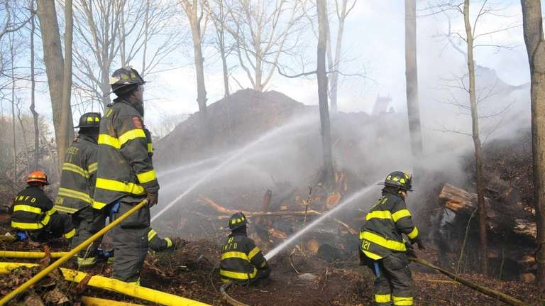 Firefighters battle mulch fire that broke out at