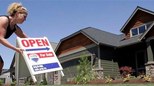 Realtor Sylvia Perry sets out an open sign