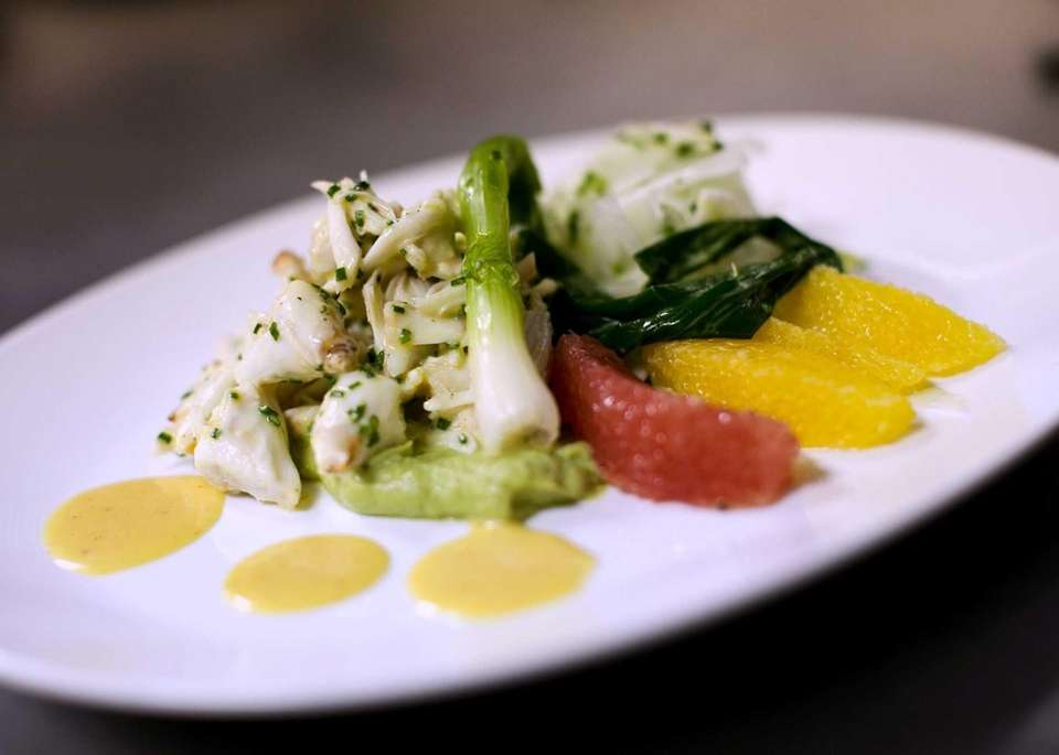 Blue crab claw salad is served at Market