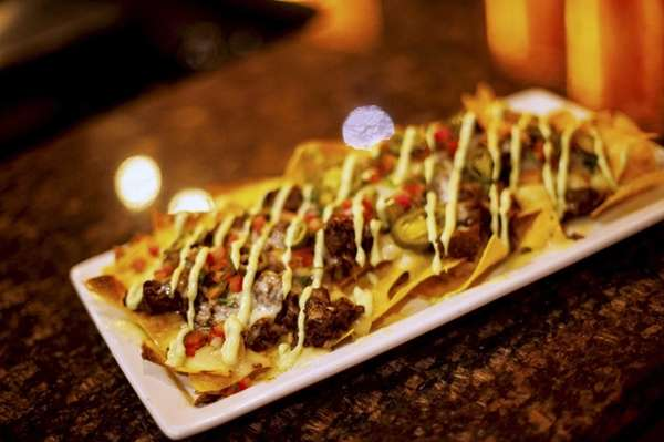 Fuego Picante's smoked short-rib nachos, topped with fresh