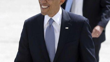President Barack Obama arrives to John F. Kennedy
