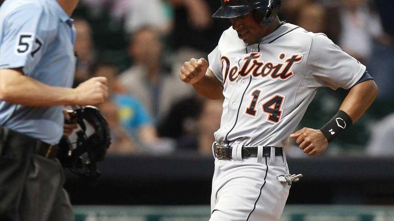 Detroit Tigers centerfielder Austin Jackson scores on a