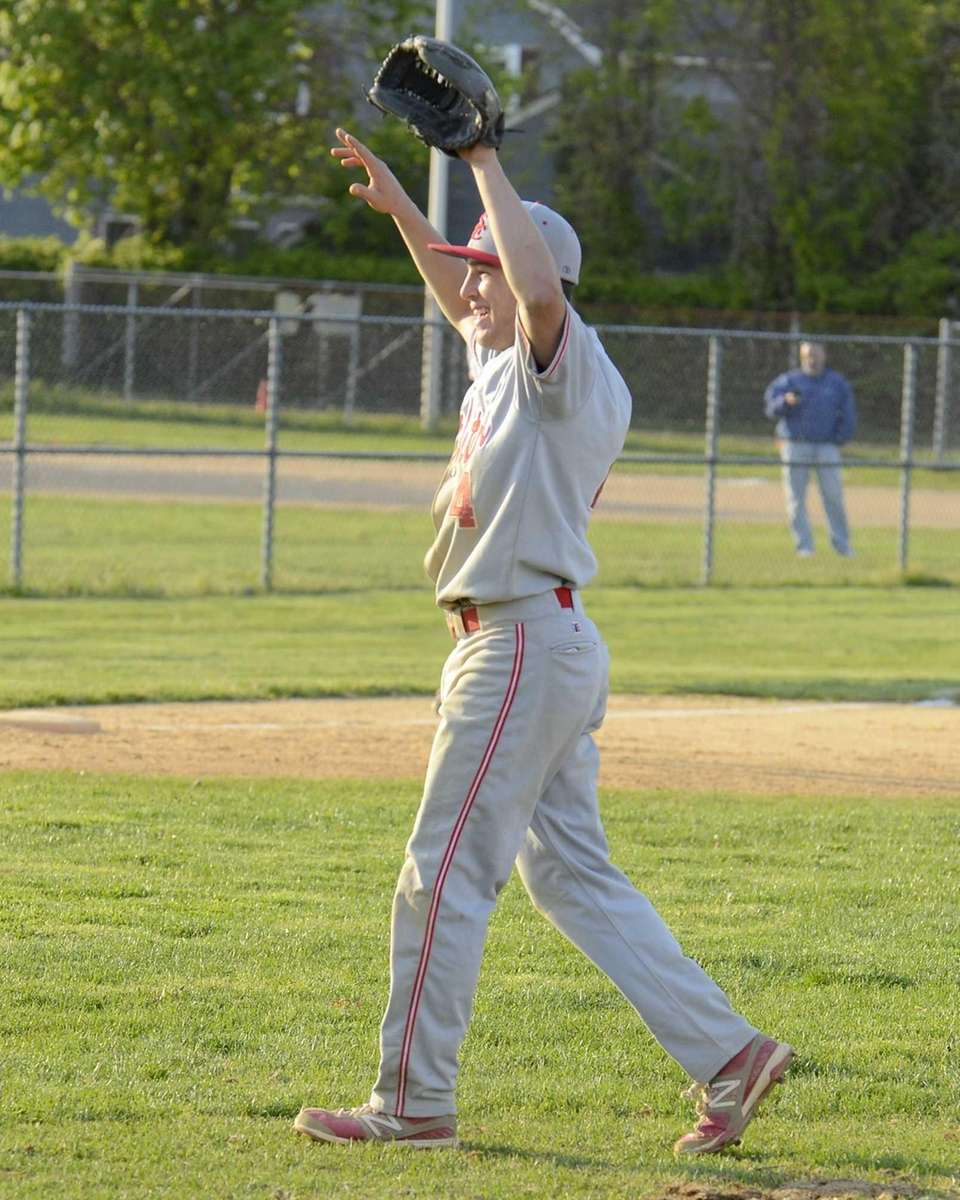 Smithtown East's Nick Aurrichio #4 raises his arms