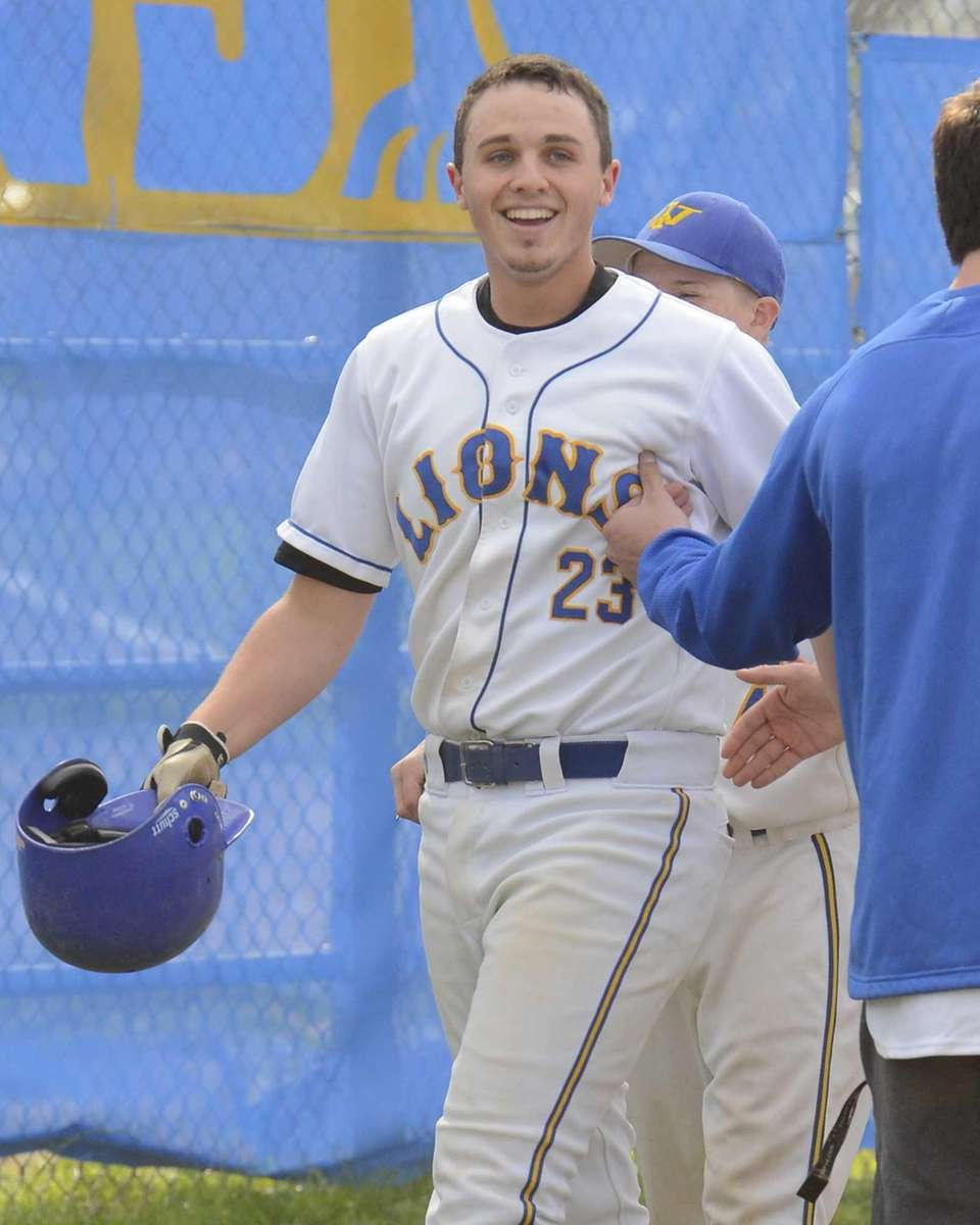 West Islip's Dan Daley #23 smiles after belting