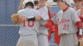 Smithtown East's Matt Kelly #10 is congratulated by