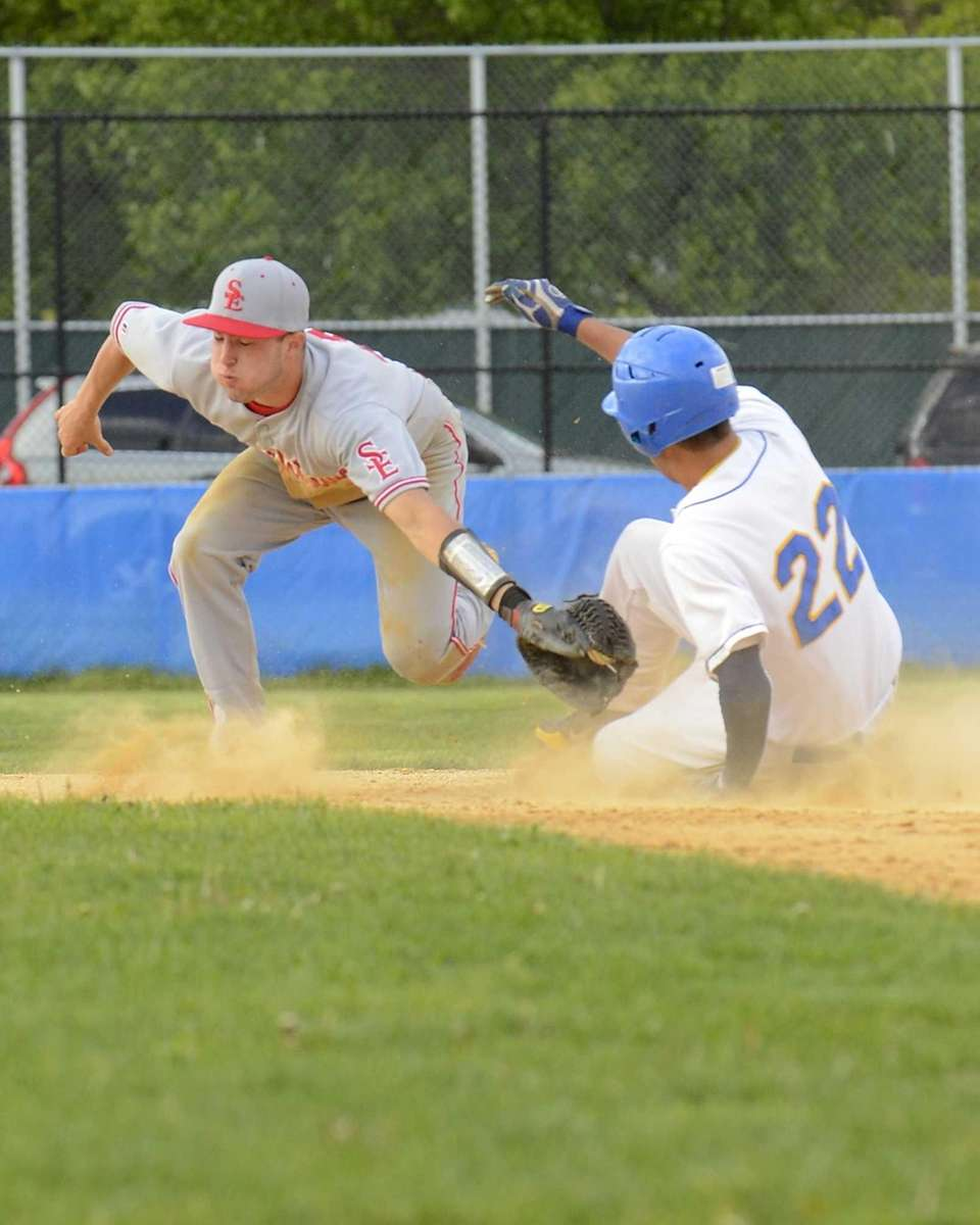 West Islip's Peter Vorilas #22 safely slides around