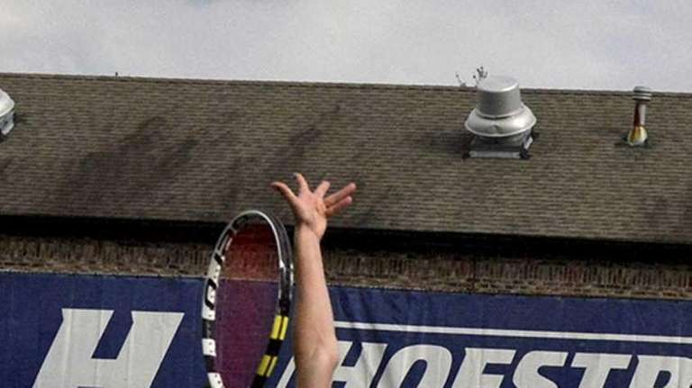 John D'Alessandro of St. Anthony's serves during a