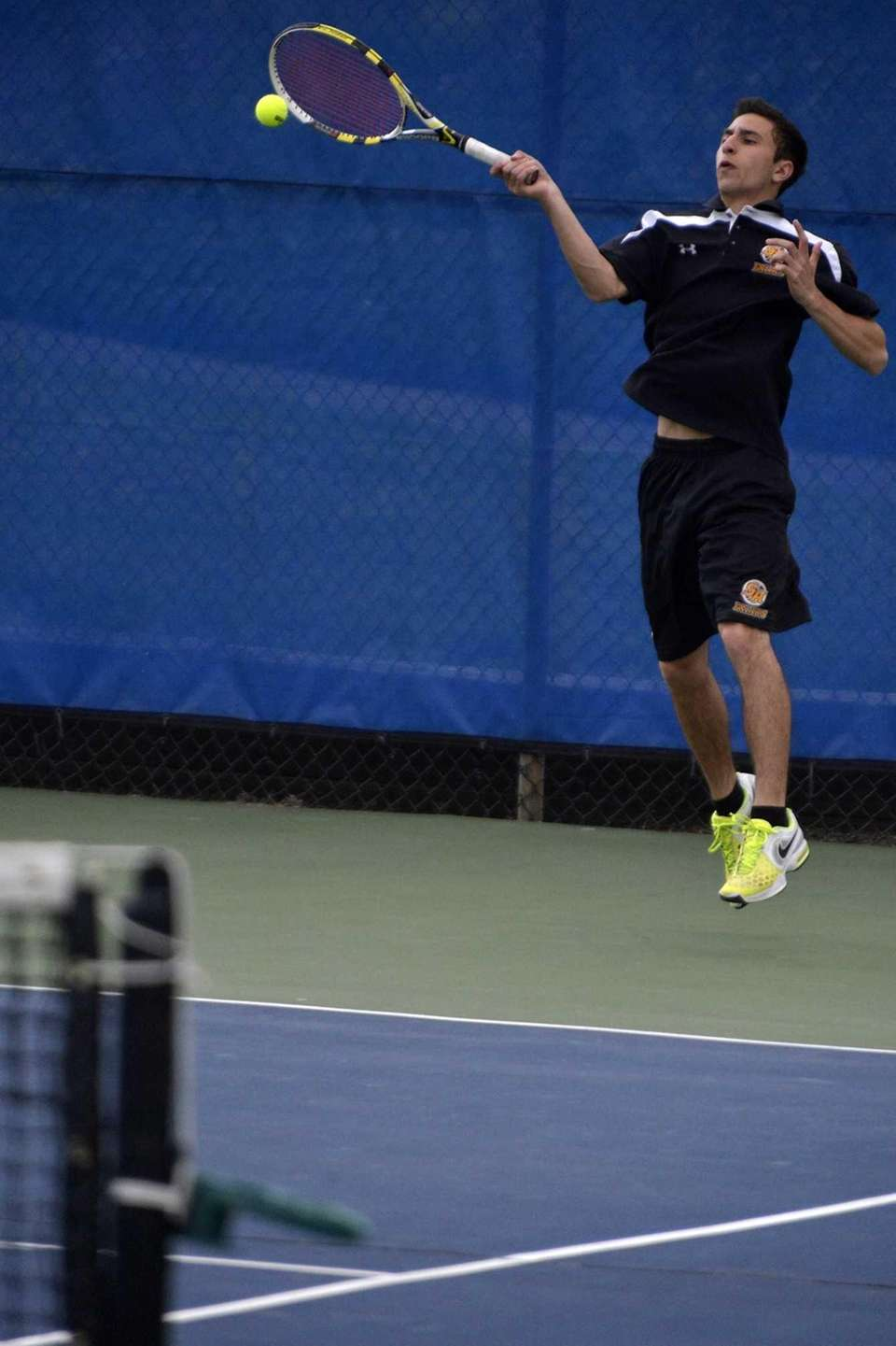 John D'Alessandro of St. Anthony returns a forehand