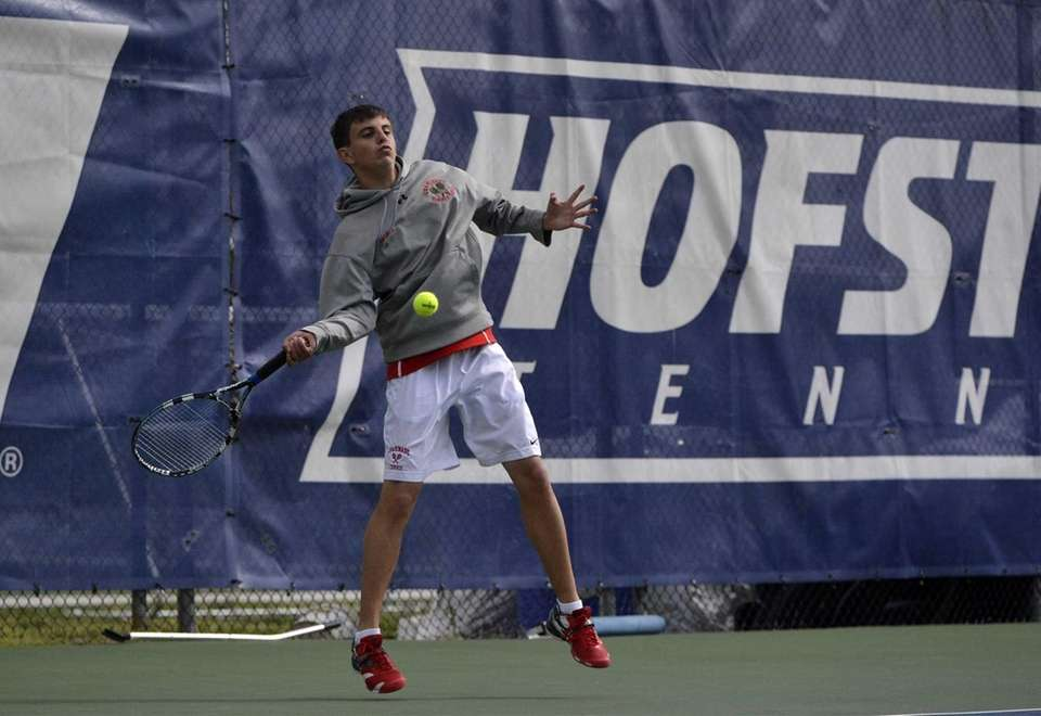 Cameron Posillico of Chaminade returns a forehand to