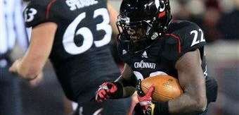 Cincinnati running back Jameel Poteat runs the ball