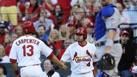 The St. Louis Cardinals' Matt Carpenter (13) is