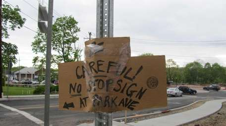 Hand-lettered sign at end of Cliftwood Drive warns