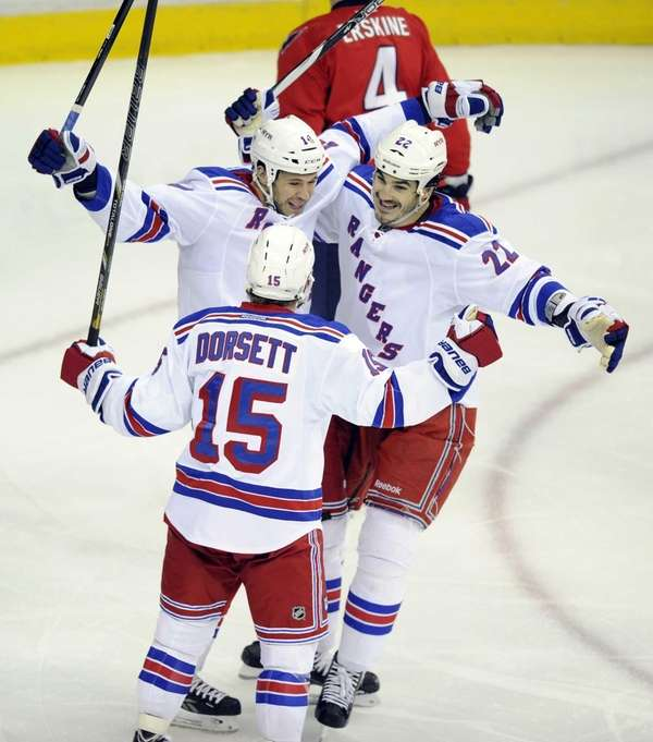Taylor Pyatt celebrates his goal with Derek Dorsett