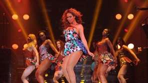 "Beyonce performs the song ""Grown Woman"" on her"