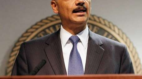 Attorney General Eric Holder addresses the media following