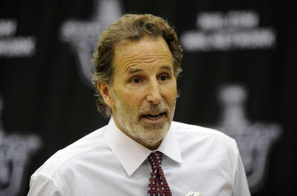 John Tortorella talks to the media during a