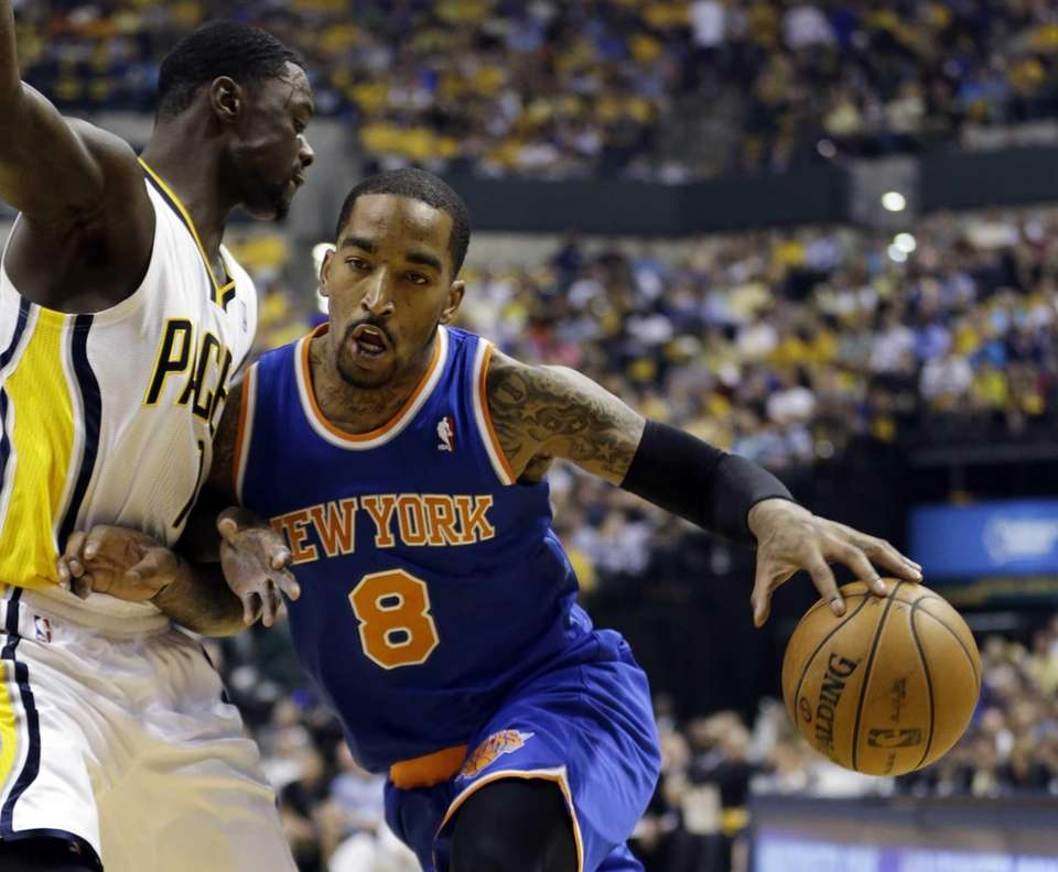 Knicks' J.R. Smith loses the ball as he