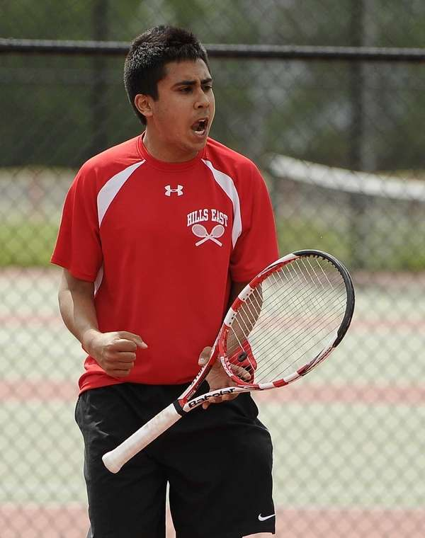 Half Hollow Hills East's Zain Ali reacts during