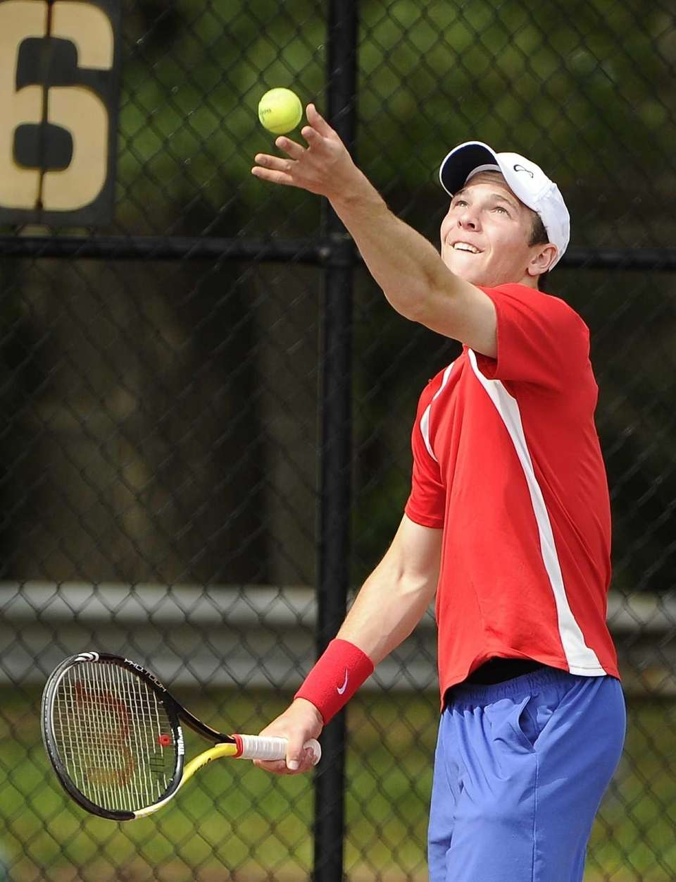 Half Hollow Hills East's Jeff Cherkin serves during