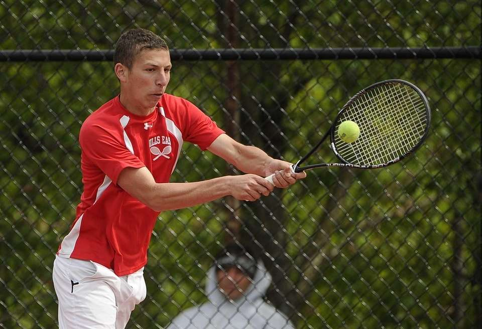 Half Hollow Hills East's Michael Leffler returns the