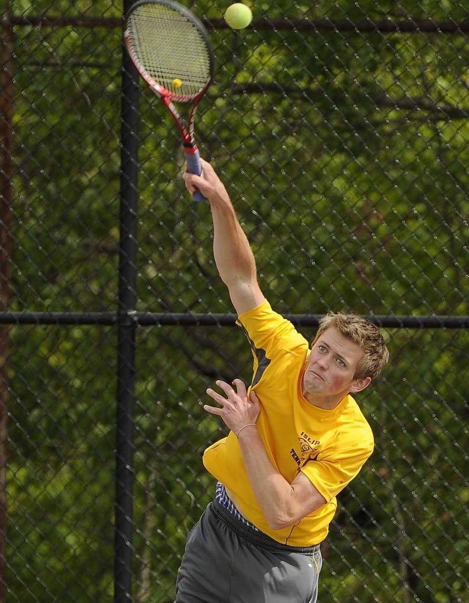 Islip's Connor Jeran serves during the consolation doubles