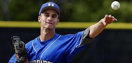 Hauppauge starting pitcher Nick Fanti delivers during a