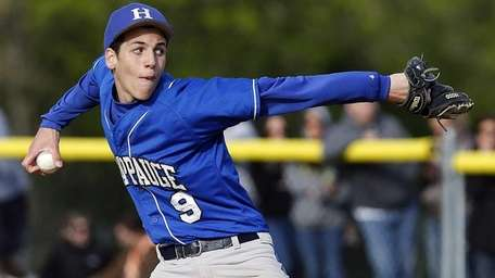 Hauppauge relief pitcher Mike Basil pitches in the