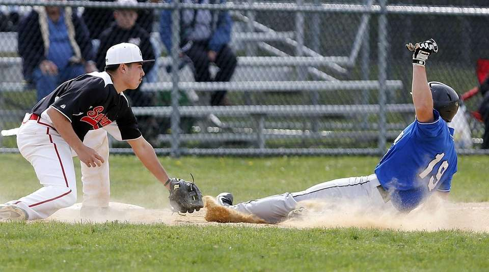 Hauppauge's Cory Wood is tagged at third by