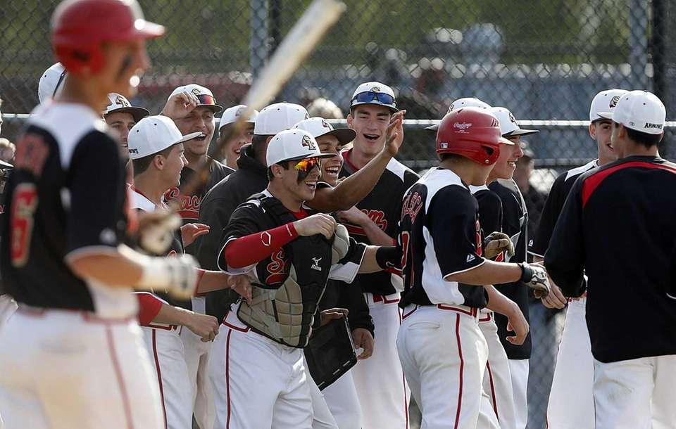 Sachem teammates congratulate Anthony Telesca for his score
