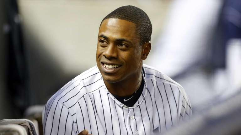 Curtis Granderson of the Yankees looks on against