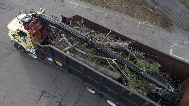 Crews drop of debris at a Nassau collection