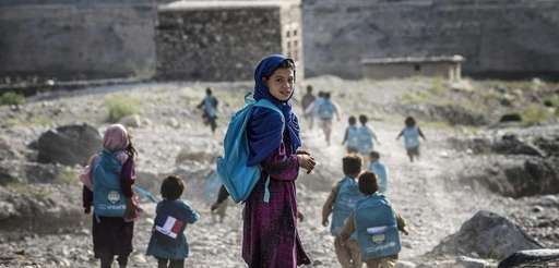 Afghan children run to school, September 2012. Khaled