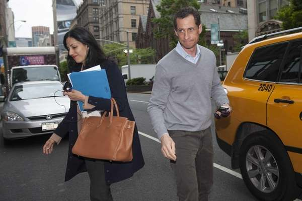 Anthony Weiner and his wife, Huma Abedin, exit