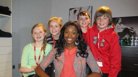 Singer and actress Coco Jones with Kidsday reporters