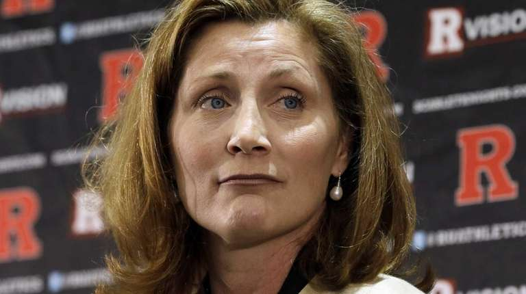 Julie Hermann listens during a news conference where