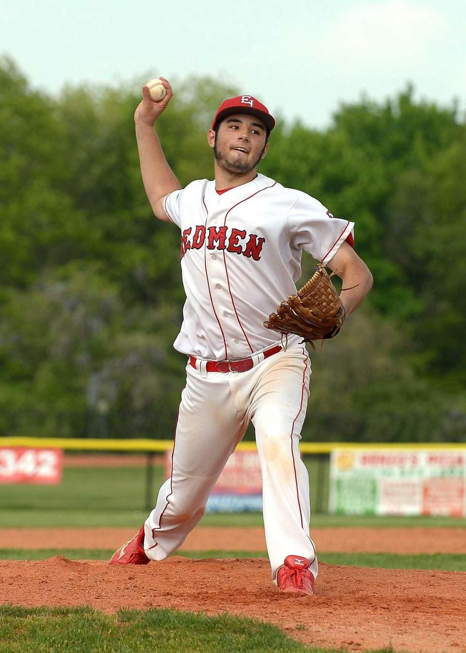 East Islip's Ken Rotunno (22) delivers a strike