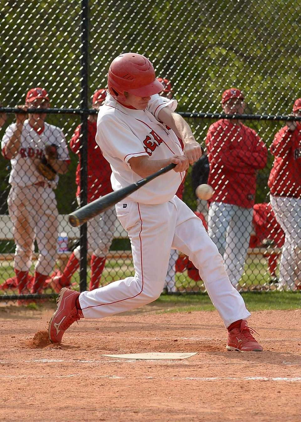 East Islip's Jared Voullo (28) takes a swing