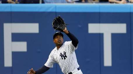 Curtis Granderson makes a catch for the first