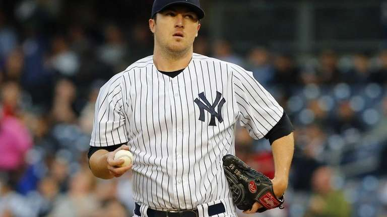Phil Hughes of the Yankees stands on the