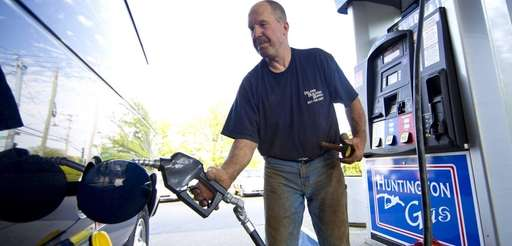 Kurt Hucke, of Huntington, pumps gas Wednesday at
